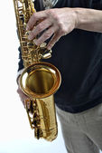 Young man playing saxophone — Stock Photo