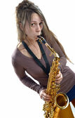 Young woman playing the saxophone — Stock Photo