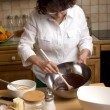 Mature woman makes the pastry in the kitchen — Stock Photo #43669183