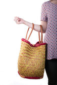 Young woman holding a basket and a mobile phone — Stock Photo