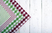 Colorful napkins on a white wooden board — Stock Photo