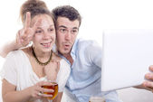 Young couple taking a picture with a tablet  — Stock Photo