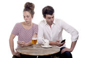 Couple Disgruntled at the terrace of a cafe — Stock Photo