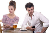 Young couple with their phones are Disgruntled — Photo