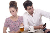 Young couple with their phones are Disgruntled — Stock Photo