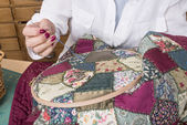 Mature woman by sewing and quilting — Стоковое фото