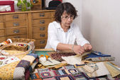Mature woman by sewing and quilting — Stok fotoğraf