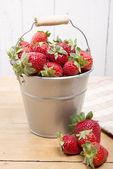 Strawberries in a small metallic bucket — Stock Photo