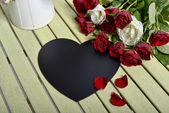 Roses and black heart  — Stock Photo