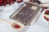 Cookbook with red fruits — Stock Photo