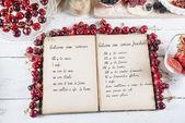 Cookbook with ingredients — Stock Photo