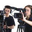 Young man and young woman with video cameras — Stock Photo #47211181