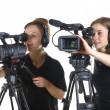 Two young women with video cameras — Stock Photo #47211351