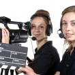 Two young women with video cameras — Stock Photo #47211601