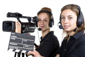 Two young women with  video cameras — Stock Photo