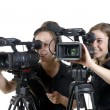 Two young women with video cameras — Stock Photo #47383321