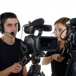 Young man and young woman with video cameras — Stock Photo #47383343