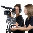 Two young women with video cameras — Stock Photo #47383385