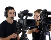 Young man and young woman with video cameras — Foto Stock