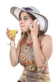 Pretty woman on the phone and drinking glass — Stock Photo