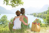 Two lesbians in nature admire the landscape — Stock Photo