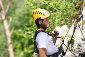 Steeplejack climbing a rock wall  — Stock Photo