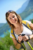 Young woman is hiking in the Alps — Foto Stock