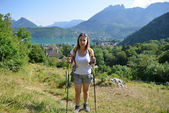 Young woman is hiking in the Alps — Stock Photo