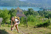 Pretty young woman is hiking in mountains — Photo