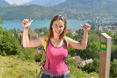 Pretty young woman is hiking in mountains — Stock Photo