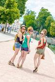 Three young women go shopping — Stock Photo