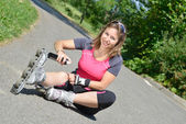 Young woman fell on skates — Stock Photo