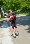 Pretty young woman doing rollerskate on a track — Stock Photo