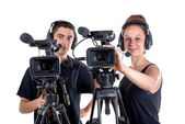 Young man and young woman with  camera — Stock Photo