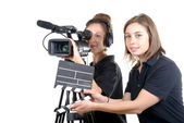 Two young women with  camera — Stock Photo