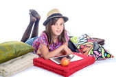 Schoolgirl with a digital tablet and fruit — Stock Photo