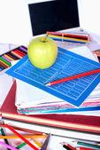 School supplies with an apple — 图库照片