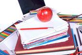 School supplies with an apple — Zdjęcie stockowe
