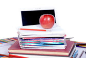 School supplies with an apple — Stock Photo