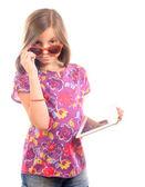 Schoolgirl with a digital tablet — Stock Photo