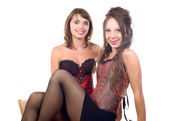 Two young women dressed in a corset — Foto Stock