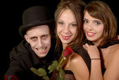 Two women and a man in disguise halloween — Stock Photo