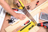 A man made a piece of furniture with various carpentry tools — Stock Photo