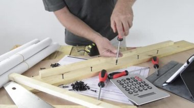 A man made a piece of furniture with various carpentry tools — Stock Video