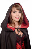 Pretty girl dressed in a black cape for halloween — Stock Photo