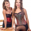 Two young women dressed in a corset — Stock Photo #51595055