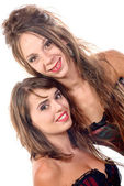 Two young women dressed in a corset — Stock Photo