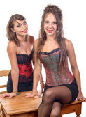Two young women dressed in a corset — Stockfoto