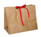 Torba Kraft papier prezent z kokardą czerwony na białym tle z liny obsługuje 002 — Zdjęcie stockowe