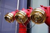 002 Shiny metal red water plug with seals and plugs on the street, Красный блестящий металлический пожарный кран  с пломбами и затычками на улице — Stock Photo